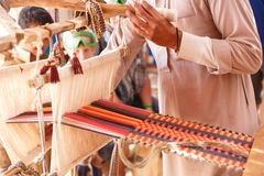 Man produces the fabric. A man produces the fabric on a traditional loom in the Bedouin village, Egypt stock photos