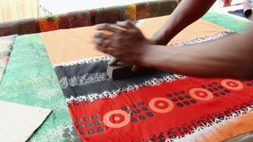 Man produces stamp print cloth at the workshop at the New Market in Dhaka, Bangladesh. stock footage