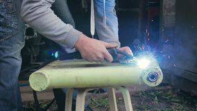 Violation of safety regulations when working with the welding machine stock footage