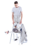 Man professional fencer looking at fencing equipment on chair Stock Photo