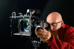 Man with a professional movie camera Royalty Free Stock Photo