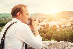 Man with professional photo camera take landscape picture Royalty Free Stock Images