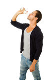 Man in profile drinking fresh water Stock Photo