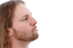 Man in profile is looking scaptical Royalty Free Stock Photography