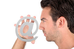 Man in profile with sign Stock Photography