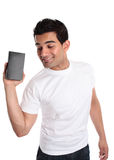 Man promoting selling a boxed product. A smiling energetic man markets or sells a boxed product or merchandise royalty free stock images