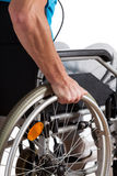 Man propelling wheelchair Royalty Free Stock Photo