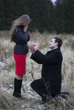 Man proposes to woman in park Stock Photos