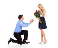 Man proposing. Young men down on his knee proposing to girlfriend Royalty Free Stock Photo