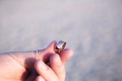 Man proposing on the beach Stock Photos