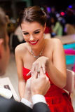 Man proposing with an engagement ring to his love. Young men proposing with an engagement ring to his love in a restaurant Stock Images
