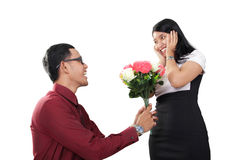Man proposing with flowers, isolated on white Stock Photography