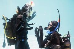 Man proposing marriage in scuba gear Stock Image