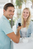Man proposing marriage to his shocked blonde girlfriend Royalty Free Stock Photos