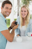 Man proposing marriage to his shocked blonde girlfriend Stock Photo