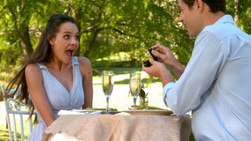 Man proposing marriage to his shocked girlfriend stock footage