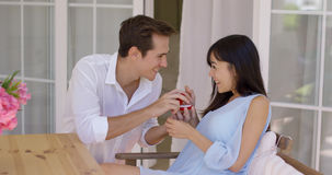Man proposing a marriage to woman with ring Stock Images