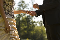 Man proposing or marrying his sweetheart Stock Image