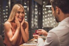 Man proposing in restaurant Royalty Free Stock Photos
