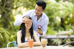 Man proposing to girlfriend offering engagement ring Royalty Free Stock Image
