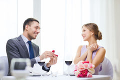 Man proposing to his girlfriend at restaurant Royalty Free Stock Images