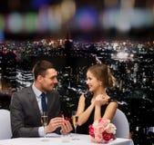 Man proposing to his girlfriend at restaurant Royalty Free Stock Photos
