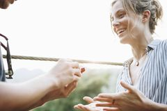 Man proposing to his happy girlfriend outdoors love and marriage concept Royalty Free Stock Image