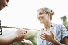 Man proposing to his happy girlfriend outdoors love and marriage concept Royalty Free Stock Photography