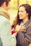 Man proposing to a woman in the autumn park Stock Photo