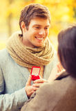 Man proposing to a woman in the autumn park Royalty Free Stock Photos