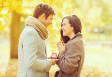 Man proposing to a woman in the autumn park Royalty Free Stock Images