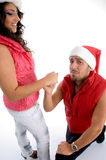 Man proposing to the woman with christmas hat Royalty Free Stock Photography