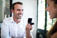 Man proposing to woman offering engagement ring Stock Image