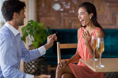 Man proposing to woman offering engagement ring Royalty Free Stock Photography
