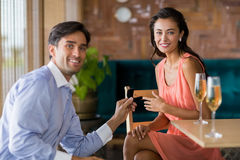 Man proposing to woman offering engagement ring Stock Images
