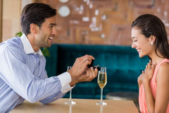 Man proposing to woman offering engagement ring Stock Image