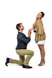 Man proposing woman while kneeling and holding hands Stock Images