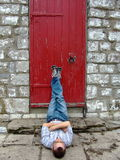 Man propping feet on door  Royalty Free Stock Image