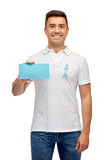 Man with prostate cancer awareness ribbon and card Stock Image