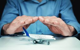 Man protect airplane. Travel insurance concept. stock photos