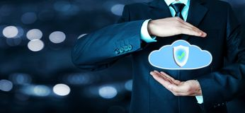 Man protect a data cloud. Cloud information data protection. Royalty Free Stock Images