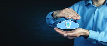 Man protect a data cloud. Cloud information data protection. Stock Photo