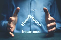 Man protect house insurance words. Real estate concept Stock Images