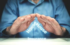 Man protect house insurance words. Real estate concept Stock Photo