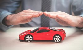 Man protect red car. Car insurance concept. Stock Images