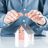 Man protecting his house with cupped hands Stock Photo