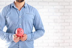 Man protecting his savings Stock Images