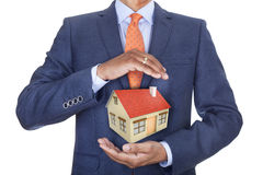 Man protecting house Stock Image
