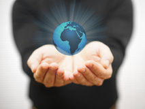 Man is protecting the virtual earth with his hands Stock Photo