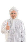 Man in protective clothes giving a thumbs-up sign Stock Photography